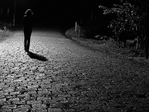 WALKING THROUGH A DARK PATH