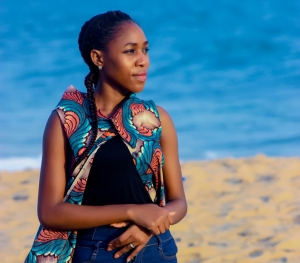 Young black woman endometriosis warrior at the beach staring into space Inspiring image
